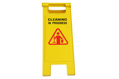 Cleaning in process and caution wet floor symbol Stock Image