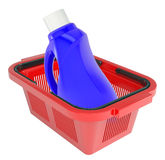 Cleaning product in shopping basket Royalty Free Stock Photos