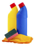 Cleaning Products Bottles Sponge and Duster. Bottles of household cleaning fluid a cloth and sponge on an isolated white background with a clipping path Royalty Free Stock Photos