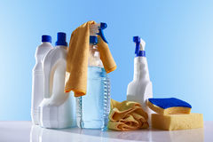 Cleaning products and equipment on white table overview Royalty Free Stock Images