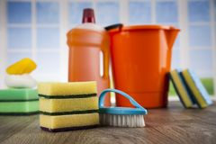 Cleaning products. Home concept and window background. House cleaning with various cleaning tools royalty free stock image