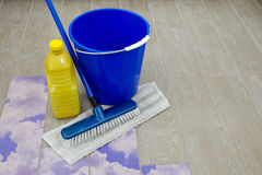 Cleaning products on old floor Stock Image