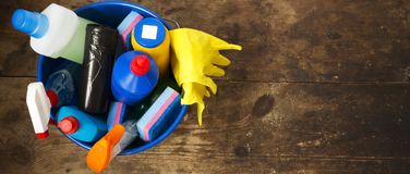 Cleaning products on wooden surface. House cleaning concept. Top view. From above. Space for text stock photography