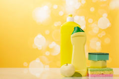 Cleaning products on yellow Stock Photos
