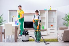 The cleaning professional contractors working at house. Cleaning professional contractors working at house Stock Photography
