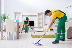 The cleaning professional contractors working at house royalty free stock photo