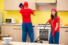 The cleaning professional contractors working at kitchen. Cleaning professional contractors working at kitchen stock images