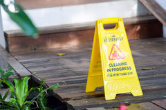 Cleaning progress caution sign in garden Stock Photos
