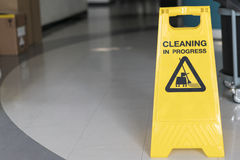 Cleaning progress caution sign in office. Close up Royalty Free Stock Photography