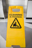 Cleaning in progress caution sign in office Royalty Free Stock Photography