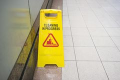 Cleaning progress caution sign in public toilet Royalty Free Stock Image