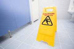 Cleaning progress caution sign in toilet Stock Photos