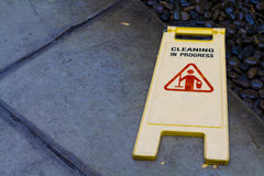 Cleaning in progress signage on wet floor Royalty Free Stock Images