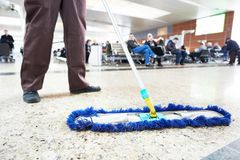 Cleaning public hall floor Stock Photo