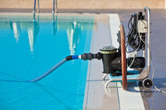 Cleaning pump working with a swimming pool Royalty Free Stock Photo