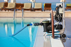 Cleaning pump working with a swimming pool Royalty Free Stock Photography
