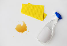 Cleaning rag, detergent spray and spilled stain Stock Image