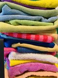 Cleaning rags in various colors. A variety of cleaning rags for household royalty free stock photos