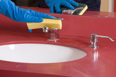 Cleaning red  Bathroom Sink Royalty Free Stock Photos