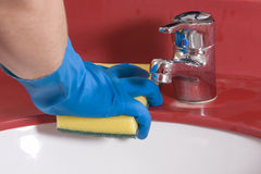 Cleaning red  Bathroom Sink Royalty Free Stock Images