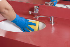 Cleaning red  Bathroom Sink Stock Photo