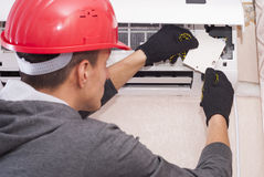 Cleaning and repairs the air conditioner Stock Image