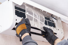 Cleaning and repairs the air conditioner stock photography