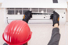 Cleaning and repairs the air conditioner Stock Images