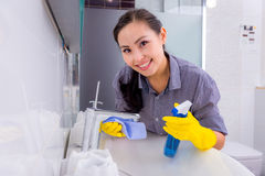 Cleaning in the restroom Stock Photo