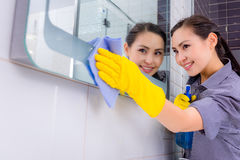 Cleaning in the restroom Royalty Free Stock Image