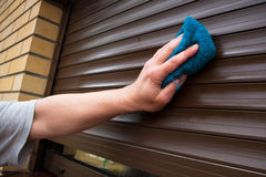 Cleaning Roller Shutters Stock Photo