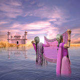 Cleaning a saree. Indian women cleaning a saree on the Ganges river Royalty Free Stock Photo