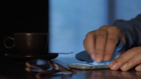 Cleaning screen on smart phone. stock footage