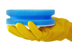 Cleaning Scrub. Hand in yellow household glove holding a blue sponge scrub isolated against a white background stock images