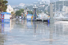 Cleaning the seaside promenade in the resort town of Yalta in th. E early morning. Ukraine, Crimea, September 18, 2012 stock photography