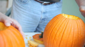Cleaning seeds from Halloween pumpkins stock video footage