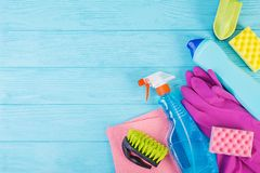 Cleaning service concept. Colorful cleaning set for different surfaces in kitchen, bathroom and other rooms. Top view stock photo