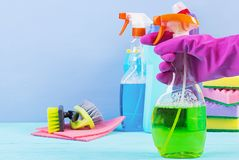 Cleaning service concept. Colorful cleaning set for different surfaces in kitchen, bathroom and other rooms. Colorful cleaning set for different surfaces in stock photo