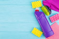 Cleaning service concept. Colorful cleaning set for different surfaces in kitchen, bathroom and other rooms. Top view. Cleaning service concept. Colorful royalty free stock photography