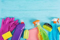 Cleaning service concept. Colorful cleaning set for different surfaces in kitchen, bathroom and other rooms. Top view royalty free stock images