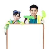 Cleaning service couple holding copyspace Stock Photos