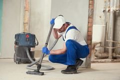Cleaning service. dust removal with vacuum cleaner royalty free stock photo