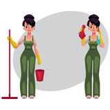 Cleaning service girl in overalls holding mop, bucket, washing windows Royalty Free Stock Photos