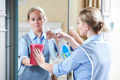Cleaning service. hotel staff clean mirror Royalty Free Stock Image