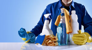 Cleaning service products and uniformed employee Royalty Free Stock Photo