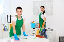 Cleaning service team at work. In office Stock Image