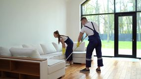 Cleaning service team at work in living room