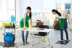 Cleaning service team at work. In office Stock Photos