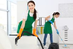 Cleaning service team at work. In office Royalty Free Stock Image