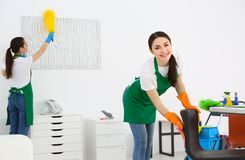 Cleaning service team at work. In office Royalty Free Stock Photography